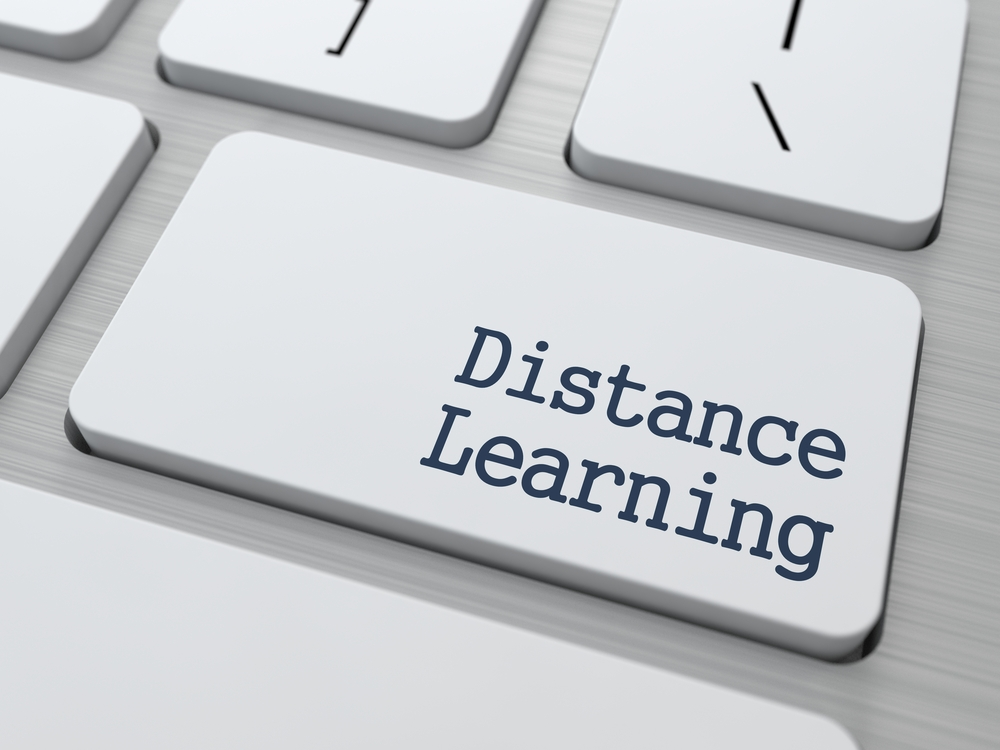 Distance Learning Button on Modern Computer Keyboard with Word Partners on It.